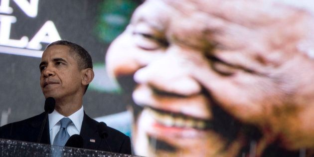 Then US President Barack Obama speaking during the memorial service for late South African President...