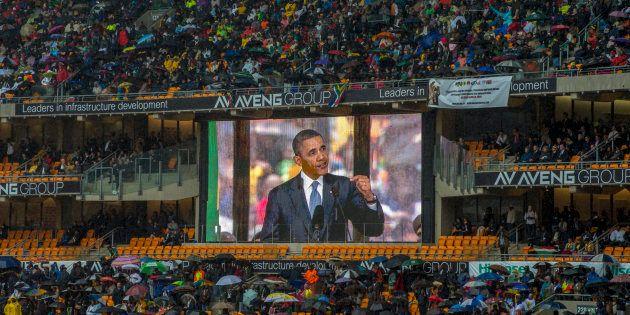 Then-U.S. president Barack Obama speaks at the memorial for Nelson Mandela at the FNB stadium in