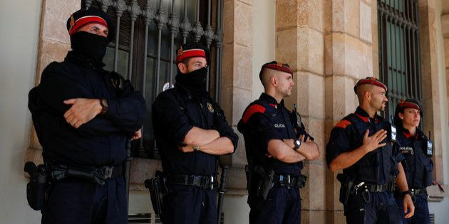 Mossos d'Esquadra, Catalan regional police officers, stand guard outside the Catalonian regional Parliament...