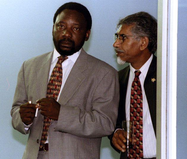 The ANC's Cyril Ramaphosa (L) and Mac Maharaj take a cigarette break during a speech, April 20,