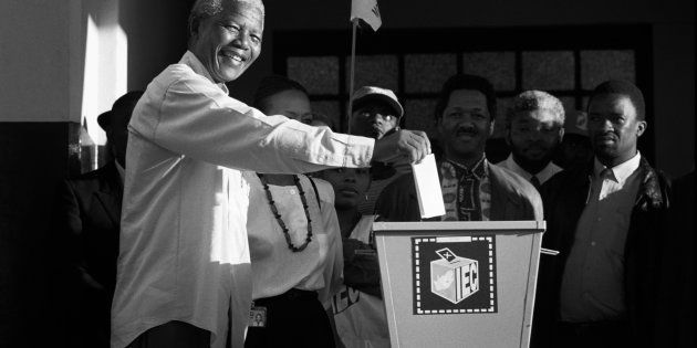 Nelson Mandela casts his historic vote in a small voting station on April 27, 1994 at Oshlange High School...