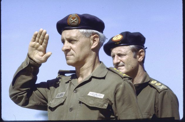 Head of the South African Defence Force General Constand Viljoen salutes (L) and Army Chief Lieutenant-General...