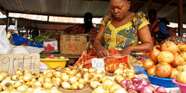 A vendor arranges onions and vegetables at her grocery stall at the Sigida Market, within Kinshasa Municipality,...