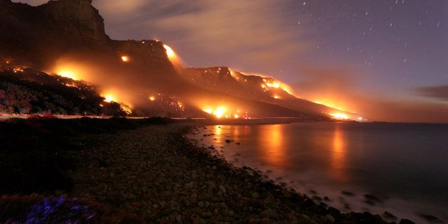 Wildfires burn along the Twelve Apostles area of Table Mountain in Cape Town, South Africa, October 13,