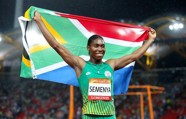 Caster Semenya celebrates winning gold in the Women's 1,500m Final at the Carrara Stadium during the...