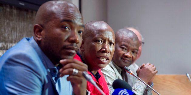 EFF leader Julius Malema (2nd L) speaks flanked by DA leader Mmusi Maimane (L), United Democratic Movement...
