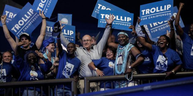 Athol Trollip and supporting members react after he is announced as the winner in the vote for federal...