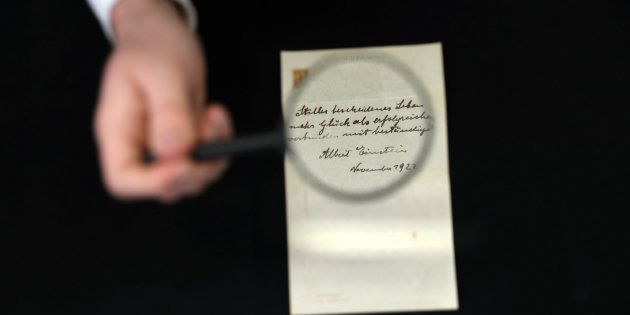 A note written on a Tokyo hotel official paper in 1922 by Albert Einstein is seen before it is sold at...