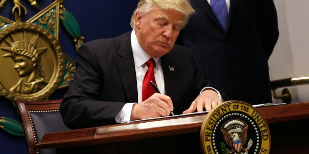 U.S. President Donald Trump signs an executive order to impose tighter vetting of travelers entering...
