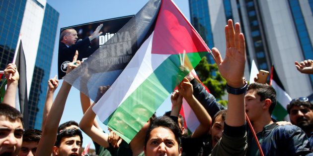 A pro-Palestinian demonstrator shouts during a protest against the U.S. embassy move to Jerusalem, near...