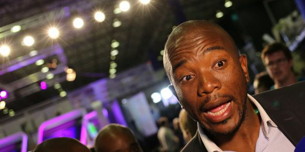 Democratic Alliance leader Mmusi Maimane gestures as he speaks to members of the media at the result...