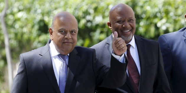 South Africa's Deputy Finance Minister Mcebisi Jonas (R) arrives with Finance Minister Pravin Gordhan...