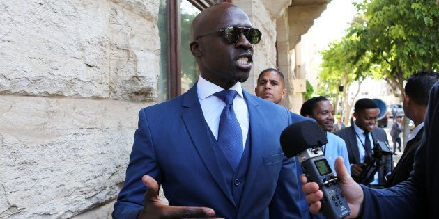 Finance Minister Malusi Gigaba speaks to members of the media after delivering his medium term budget...
