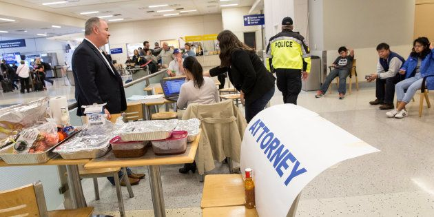 Attorneys volunteer their services at Dallas/Fort Worth International Airport after a federal judge in...