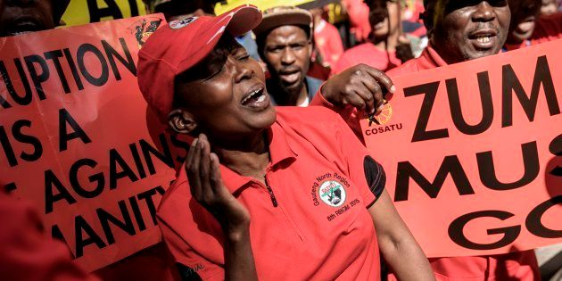 Cosatu members cheer and dance as they march through the streets protesting against corruption on September...
