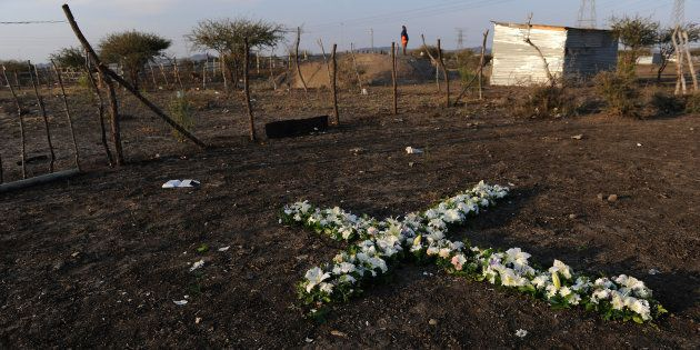 A remembrance cross made of flowers is seen during last year's commemoration of the 2012 Marikana massacre...
