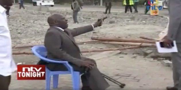 Kenyan senator Paul Njoroge waves a pistol