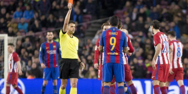 The referee shows the red card to Luis Suarez (9) of Barcelona during the King's Cup match between FC...