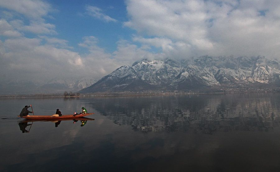 A boatman ships people on a sunny day in Dal Lake after witnessing heavy snowfall from the past few days...