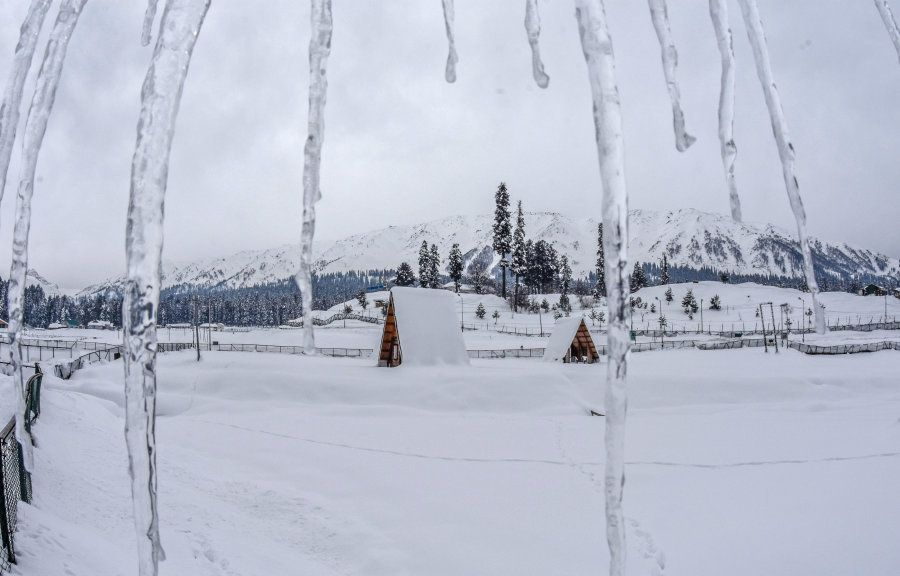 Icicles hang from a roof top after seasons first snowfall on January 22, 2017 in Gulmarg, to the west...