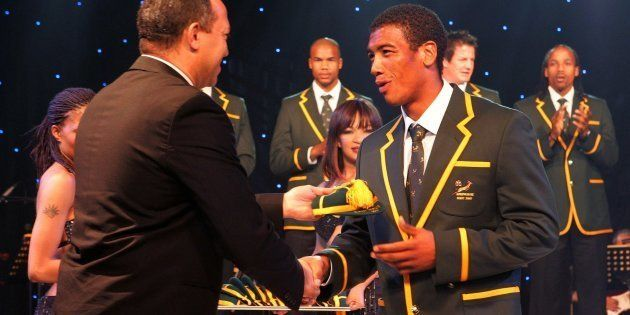 Oregan Hoskins hands Ashwin Willemse his cap for the 2007 Rugby World Cup. September 2 2007, in