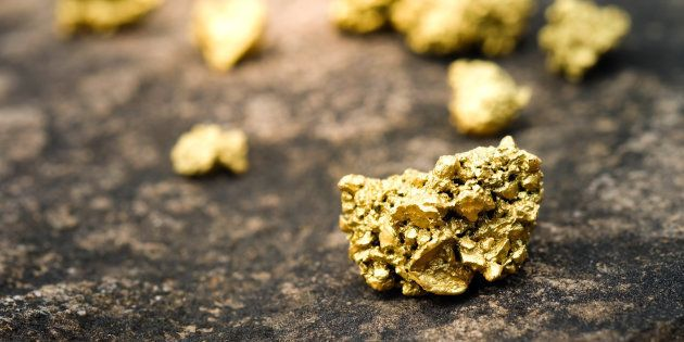A lump of gold on a stone