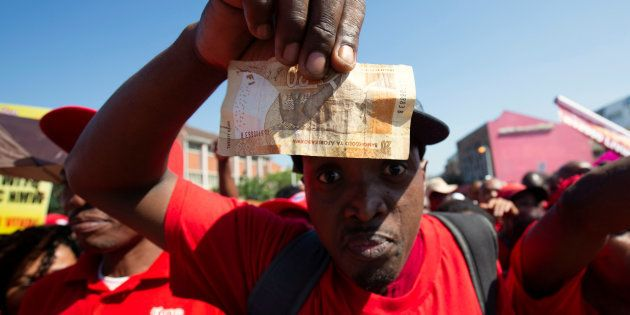 Union members protest the proposed national minimum wage during a march in Durban, South Africa, April...