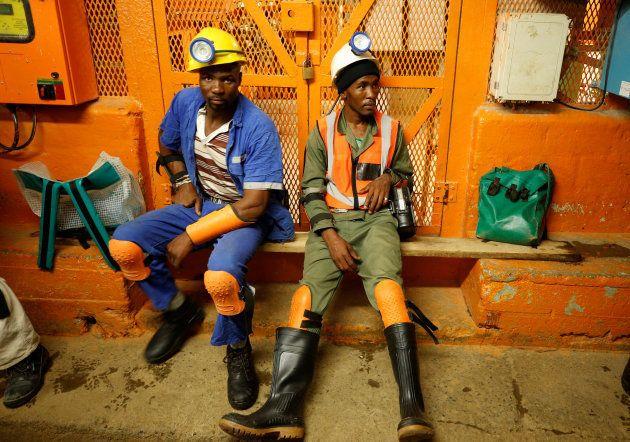 Miners take a break in a waiting area deep underground at Sibanye Gold's Masimthembe shaft in Westonaria,...