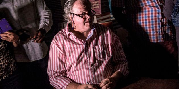 South African veteran investigative Journalist Jacques Pauw looks on as a power failure occurs during...