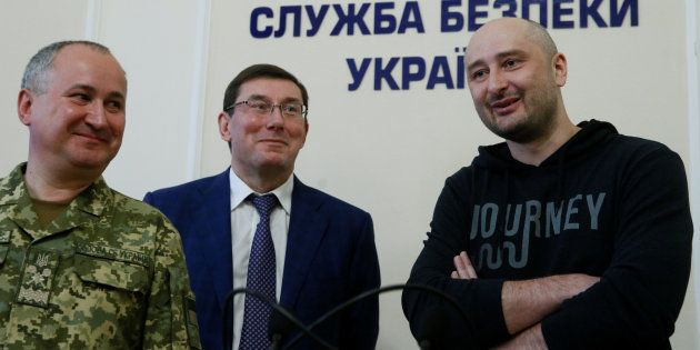 Russian journalist Arkady Babchenko (R), who was reported murdered in the Ukrainian capital on May 29,...