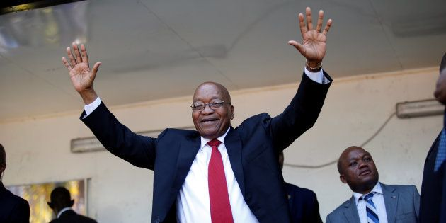 Jacob Zuma, former president of South Africa waves to his supporters on his way to the high court in...