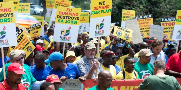 Food and Allied Workers Union members march to the European Union embassy on February 1, 2017 in Pretoria,...