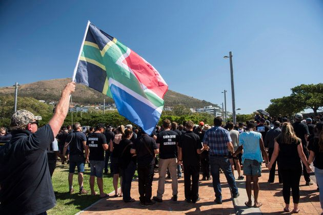 A protester waves a flag during a demonstration by South African farmers & farm workers at the Green...
