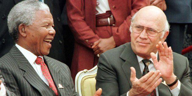 President Nelson Mandela and Deputy President FW. de Klerk share a joke outside Parliament after the...