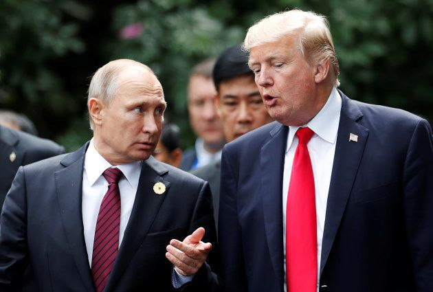U.S. President Donald Trump and Russia's President Vladimir Putin talk during the family photo session...