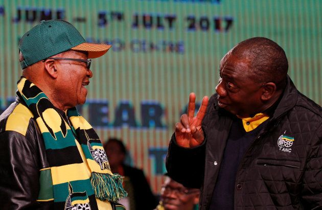 Former President Jacob Zuma (L) chats to President Cyril Ramaphosa ahead of the African National Congress...