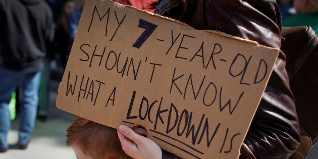 A protester holds a sign during a 'March For Our Lives' demonstration demanding gun control in Sacramento,...