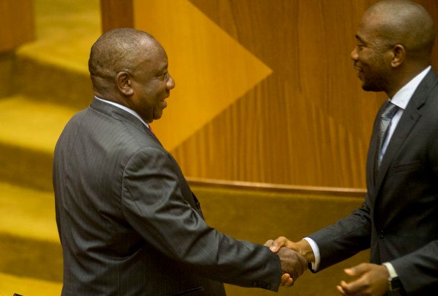 Cyril Ramaphosa is congratulated by DA leader Mmusi Maimane after being sworn in as the new president...