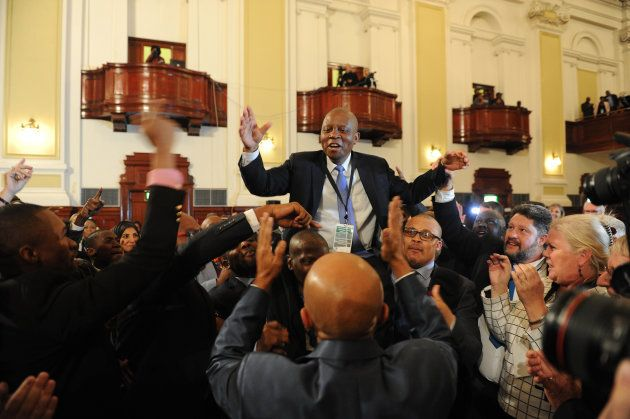 The DA's Herman Mashaba being carried on the shoulders of supporters after he was elected mayor of Johannesburg...