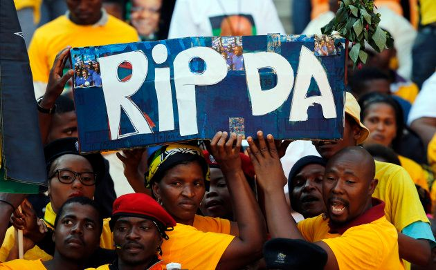 ANC supporters hold a mock coffin during their party's final election rally in Soweto, May 4,