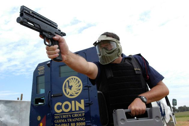 Training instructors from COIN Security Company simulate a cash in transit heist at a training ground...