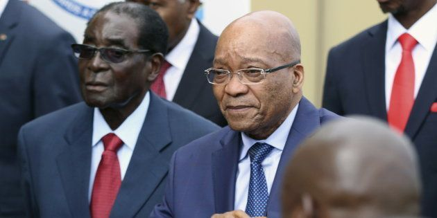 Zimbabwean President Robert Mugabe and South African President Jacob Zuma attend the summit of the Southern...