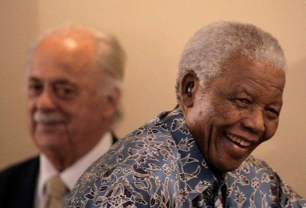 Former South African president Nelson Mandela (R) walks past George Bizos, his lifelong friend as he...