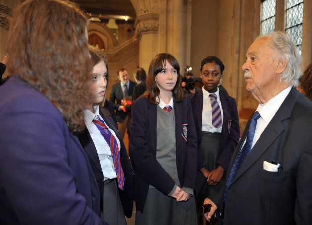 George Bizos talks to school pupils after he received the Freedom of the City of London award, in recognition...