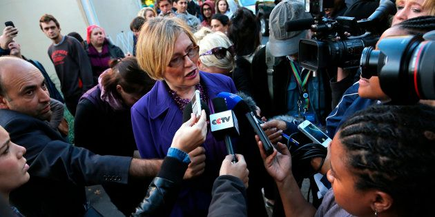 Helen Zille (C) speaks to the media before casting her vote in Rondebosch, Cape Town, May 7,