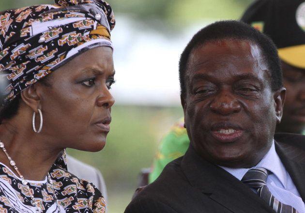 Zimbabwe's President Robert Mugabe's wife Grace talks to ex-Vice President Emmerson Mnangagwa at a gathering...