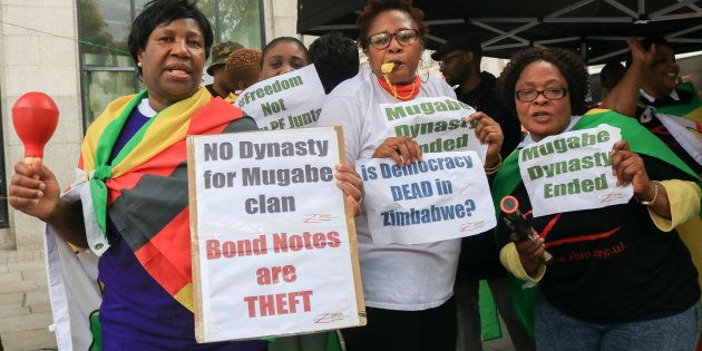 Jubilant protesters celebrate outside Zimbabwe House on 15 November, 2017, in London, England, after...