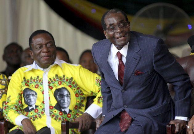 Zimbabwe's President Robert Mugabe (R) shares a joke with his vice-President Emmerson Mnangagwa during...