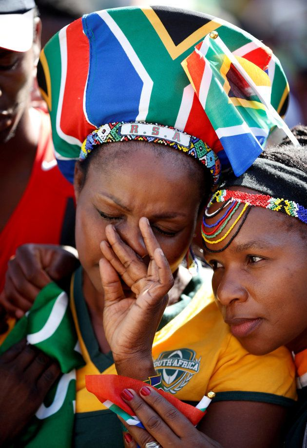South African fans react after France was announced as the Rugby World Cup host country for the Rugby...