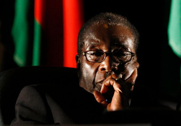 Zimbabwean President Robert Mugabe watches a video presentation during the summit of the Southern African...